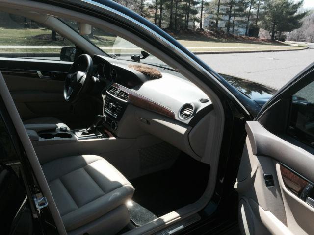2 owner mercedes c 300 sport black exterior with black and tan interior. Black Bedroom Furniture Sets. Home Design Ideas