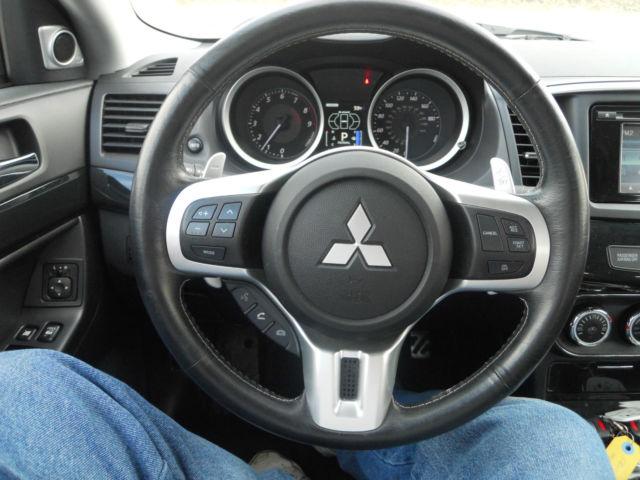 http://veh-markets.com/uploads/postfotos/2014-mitsubishi-lancer-evolution-mr-evo-awd-repairable-salvage-ez-fix-runs-drive-10.JPG