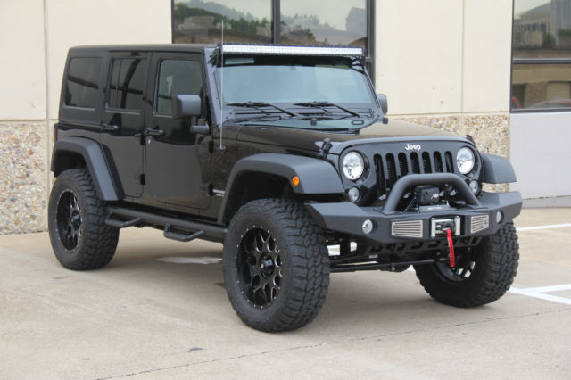 2015 black jeep wrangler 4 door lifted on 35s 8 miles. Black Bedroom Furniture Sets. Home Design Ideas