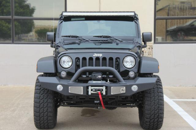 2015 black jeep wrangler 4 door lifted on 35s 8 miles. Black Bedroom Furniture Sets. Home Design Ideas