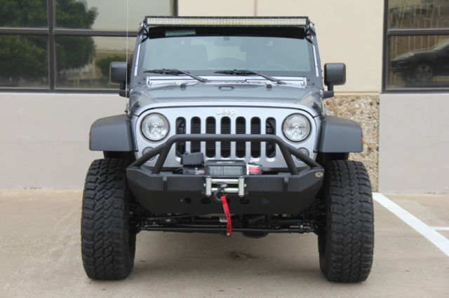 2015 Silver Jeep Wrangler Lifted On 35s 7 Miles
