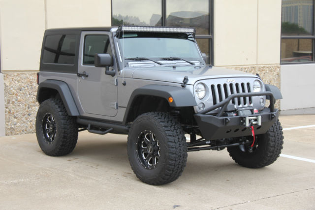 2015 silver jeep wrangler lifted on 35s 7 miles. Black Bedroom Furniture Sets. Home Design Ideas