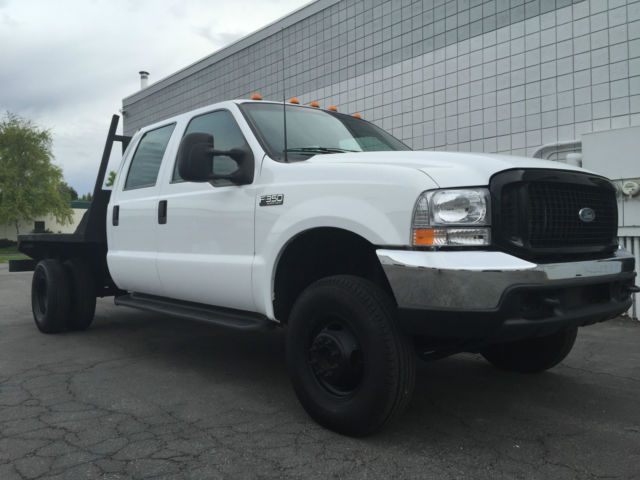 clean 1999 ford f350 crew cab xl 4x4 flatbed dually 7 3 powerstroke turbo diesel. Black Bedroom Furniture Sets. Home Design Ideas