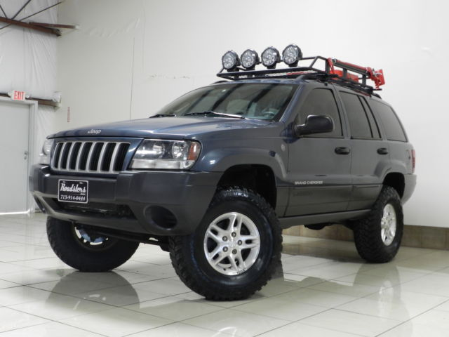custom lifted jeep grand chreokee laredo trail rated 4x4 roof bskt new tires. Black Bedroom Furniture Sets. Home Design Ideas