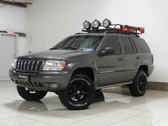jeep grand cherokee awd overland 4 7 h o v8 lifted tow roof basket vehicles markets com
